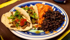 Taco shells and beans and other ingredients that you can eat with this tomato and hot pepper salsa.