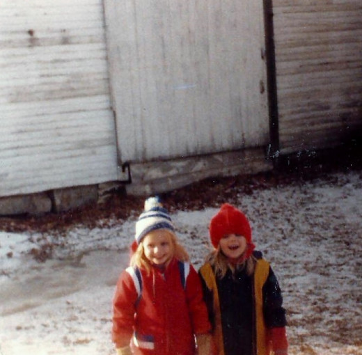 My sister and I in the snow before we moved to the new house