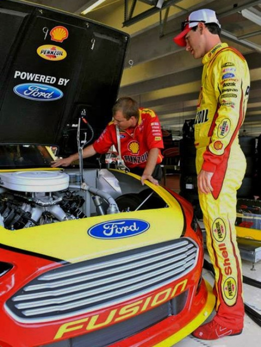Logano's team has the hood up to make adjustments. Why not allow all teams to do this?