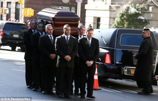 The casket of Philip Seymour Hoffman is carried into the funeral mass on Friday as hundreds of mourners attended the private ceremony Read more: http://www.dailymail.co.uk/news/article-2554010/Philip-Seymour-Hoffman-funeral.html#ixzz2vWQqOg8l  Follo
