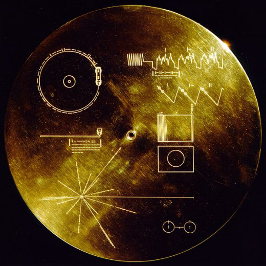 Both Voyager 1 & II are carrying a phonograph record - a 12-inch gold-plated copper disk containing sounds and images selected to portray the diversity of life and culture on Earth