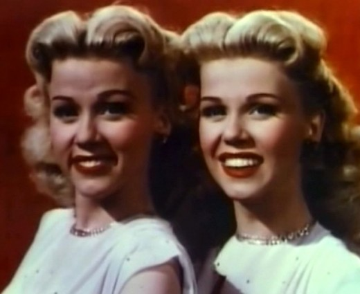 Cropped still of the Wilde twins from the film Till the Clouds Roll By