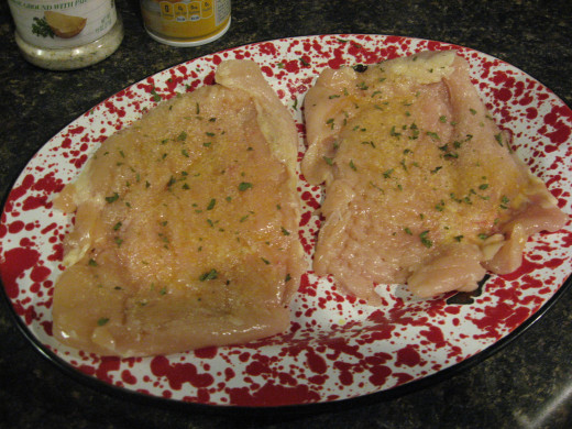 Spray with cooking spray of drizzle with olive oil. Sprinkle with seasonings.