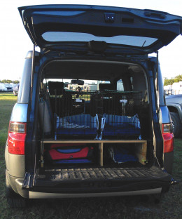 This is the back of my vehicle - with two crates permanently attached to a shelf I built for extra storage.