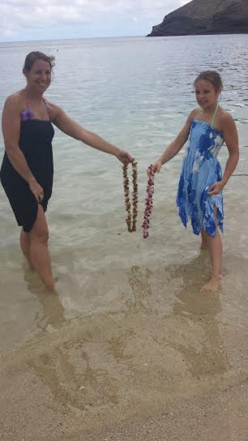 Making a wish before leaving Hawaii - letting our leis go at Hanauma Bay