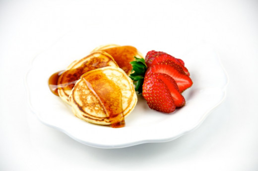 These Norwegian Sour Cream Pancakes can be served with fruit or have fruit added to the batter.