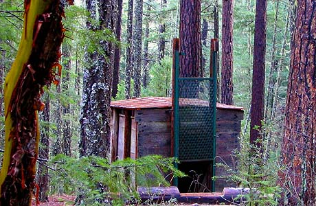 Siskiyou National Forest in the southern part of Jackson County Oregon is where possibly the only Big Foot Trap in existence in the world is located. You can see it in the photo above.