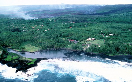 Aerial view of lava advancing down the slope toward Kalapana Village.