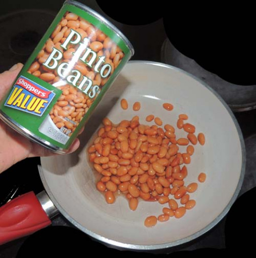 warm drained pinto beans in pan...