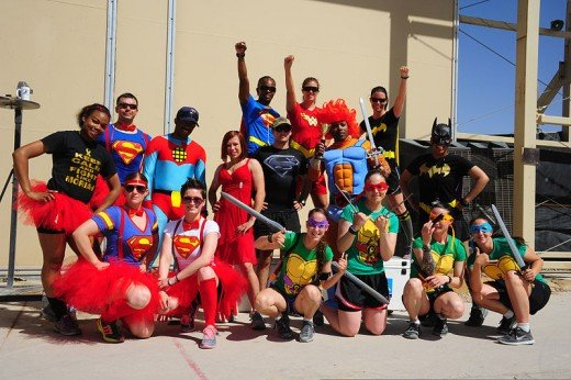U.S. Service members dressed as superheroes assigned to Combined Team Uruzgan pose at the end of the 5K Super Hero Fun Run June 7, 2013, at Multinational Base Tarin Kowt in Afghanistan.