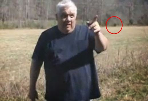 Is That A Big Foot There In The Photo With Me Circled In Red. I Was Being Interviewed For Newspaper At The Time Photo Was Taken.