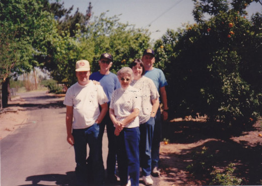 left row, back: my grandpa Vern left, front: my uncle Jeff right, back: my uncle Kenny right, middle: my mom, Janet right, front: my grandma Nelda
