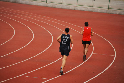 Men running in a  race.