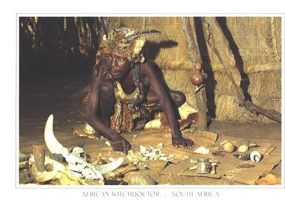 A Sangoma man surrounded by ritual bones.