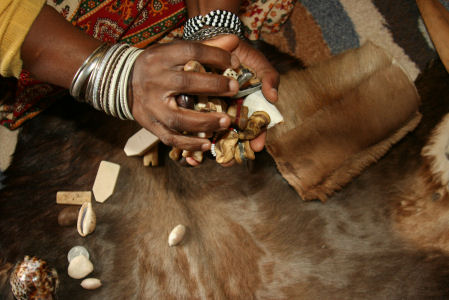 Divination tools about to be tossed for a reading by a Sangoma man.