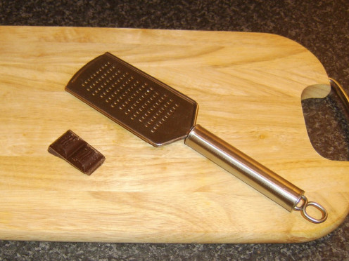 Hand grater is used to grate chocolate for garnishing