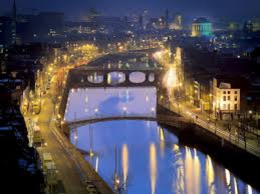 Dublin at night along the Liffey River.  Photograph taken by Polly Davies