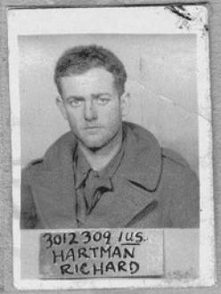 The POW ID photo of Sgt. Richard Hartman, 590th HQ Battery.