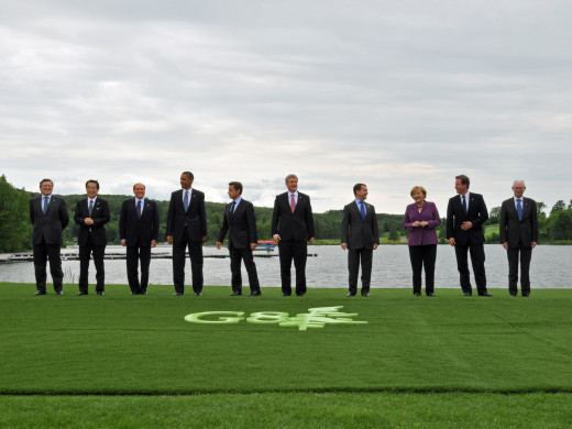 Leaders of the G8 countries, accompanied by leaders of the EU, gather for a family photo at the G8 Summit in Canada, 25 June 2010.