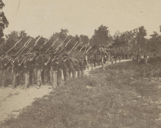 Troops pose while in a march by the flank