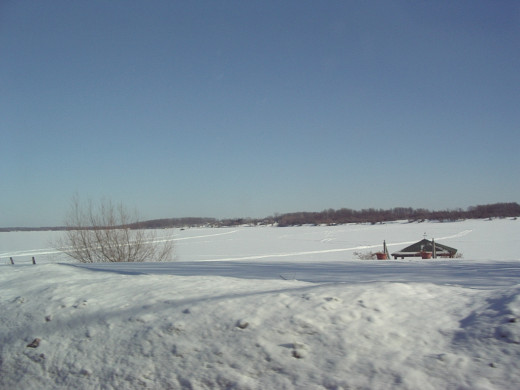 The Frozen St. Lawrence River on the first day of Spring 2014, showing snowmobile tracks from Canada to Akwesasne.