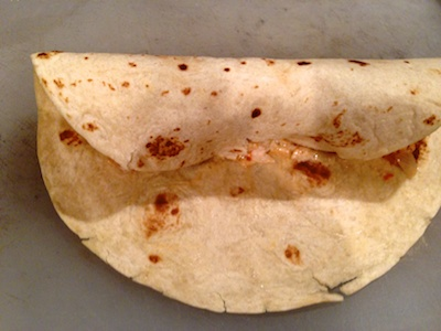 Warming tortillas makes them flexible and easy to roll.