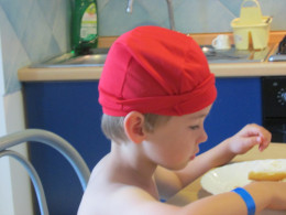 Eating in the Santa Tecla Apartments during a break from swimming (still with the swimming cap on!)