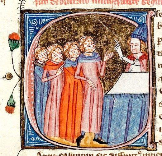 Historiated initial 'C' containing a scene showing monks, disfigured by the plague, being blessed by a priest.