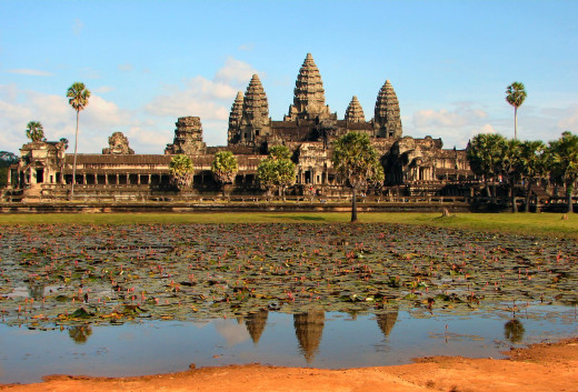 The greatest of all Khmer temples was Angkor Wat. It was started by King Suryavarman II in 1113, and covers a vast area. It contains several courtyards lined with shrines and topped with huge towers.
