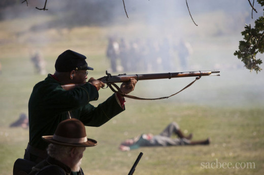 A Living Historian fires his musket