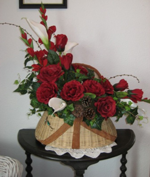 this red silk arrangement was placed in a fishing basket