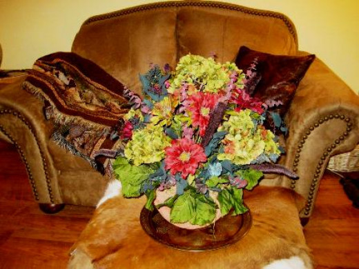 This silk arrangement creates a softer feel to a rustic room.