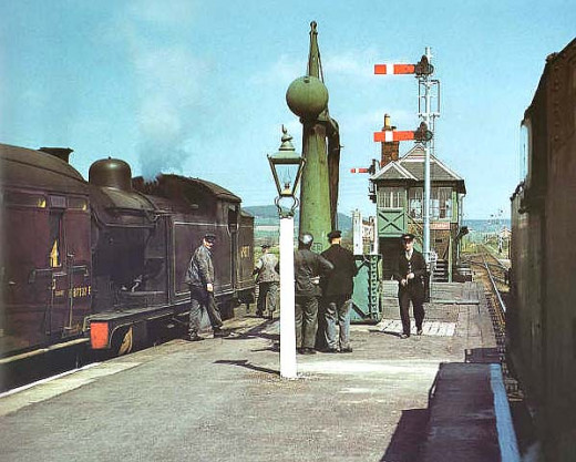 Iconic 1958 view of Battersby Station facing east to - now demolished - signal cabin that guarded the junction with the Middlesbrough line through Ayton. Signals on for A8 4-6-2 tank loco and local passenger working. Unknown tank class on the right
