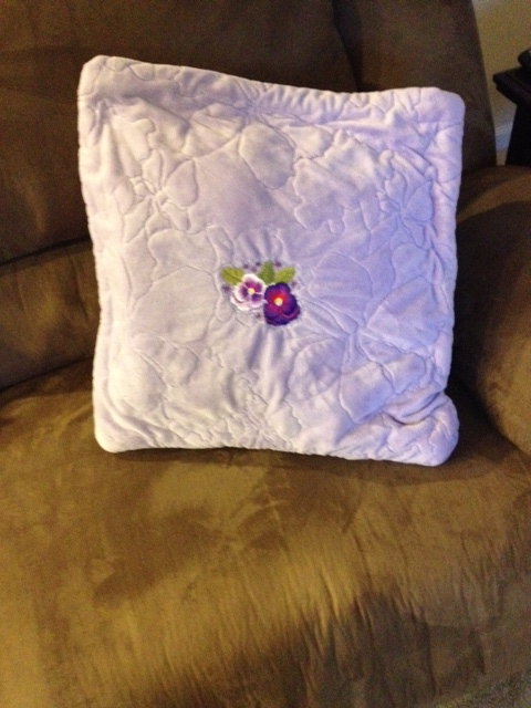 Quillow  is folded into a toss pillow for the corner of the sofa.