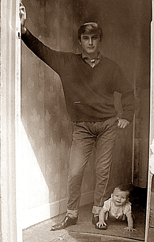 My earliest memory: My big brother posing for a photograph, which I gatecrashed after crawling speedily down the hall.