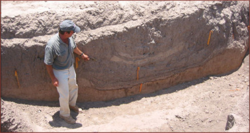This image shows project archaeologist Jonathan Mabry pointing to a cross-section of an ancient irrigation canal. Canals were critically important for farming this area in the historic era, and we have every reason to believe that canals also made an