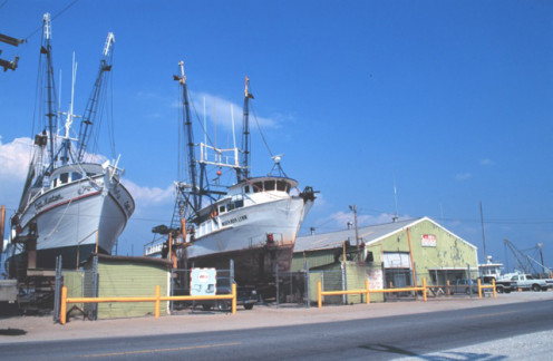 Two shrimp trawlers in dry dock at the Gulf of Mexico.