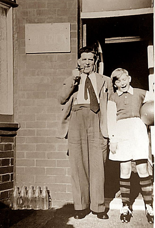Pictured with our grandad outside grandma's bed and breakfast guesthouse, my brother is wearing his rugby gear.