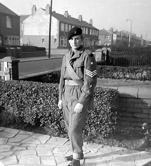 My brother in his Army uniform, standing in the front garden of the house where we grew up.