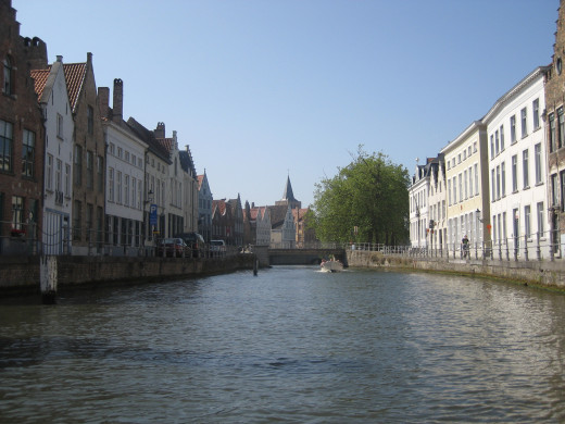 Brugge is known for its canal system. Take a boat ride through town and capture all of the charm of its row houses and Mom-and-Pop shops.