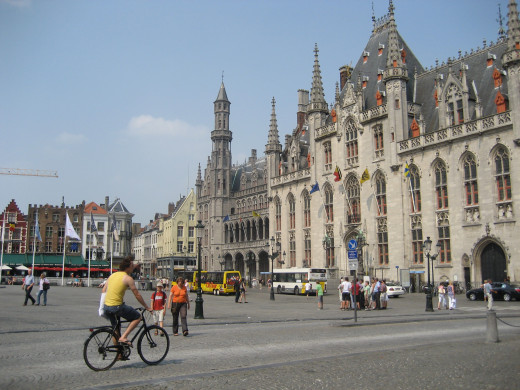 The Grote Markt is the center of activity in Brugge, with buses, bikes and tourists coming and going through the square.