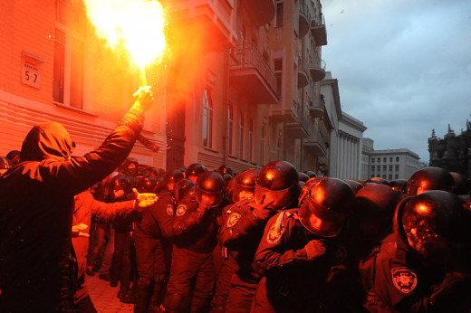 Soldiers of Ukraine's Internal Troops in riot gear and protesters clash at Bankova str, Kiev, Ukraine. December 1, 2013.