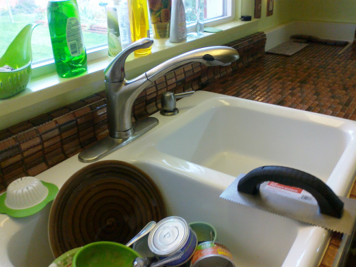 Living with a kitchen remodel in progress can be tough. But this new sink makes a sink full of dishes and recycling stuff look so much better!