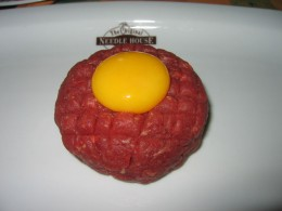 The steak tartare is said to have come from the Mongols and brought it to the Russians. Steak tartare almost always comes with a raw egg yolk on top.