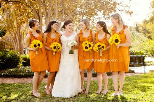 I love how they've chosen sunflowers for the bridesmaids bouquets. They lend such a summery feel!