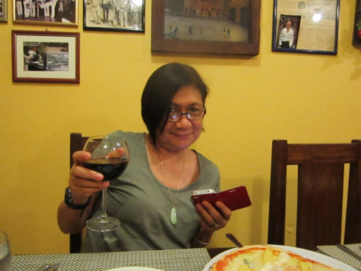 Direk Sockie Fernandez makes a toast with her red wine.