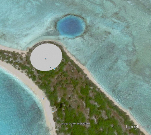 Enewatek Atoll was the site for numerous American atomic tests that were conducted on land, under water, underground and in space. This particular island shows two features for an underground test and and underwater test.
