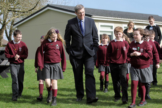Education Minister, John O'Dowd is pictured walking with pupils through the recently created outdoor conservation area at St Patrick's Primary School in Crossmaglen