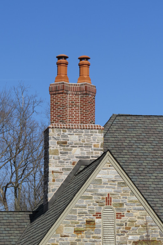 Twin chimney pots atop a double chimney.