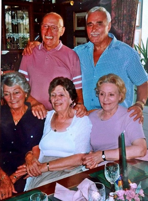 Dad standing on the left with his youngest brother, Frankie, while seated (from left) are their sisters Olive, Josie and Eileen.